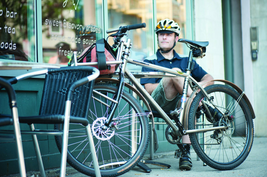 matt-okeefe-sitting-at-a-table-with-his-commuter